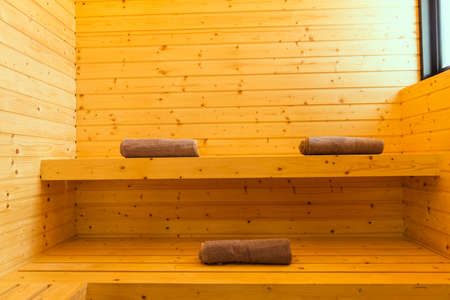 Sauna spa room of interior traditional wooden luxury golden background classic with towel