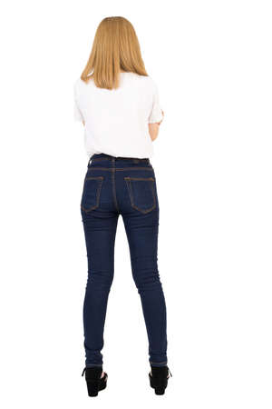 White t-shirt mockup and blue jeans skinny denim cotton slim fit concept, Young asian female portrait beautiful rear view on white isolated background Stock Photo