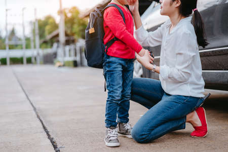 Mother dressing up a son and sending to school, Parent and pupil going to kindergarten of preschool first day back to school concept. Stock fotó - 100359487