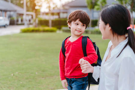 Mother get a son pupil from school after study school back to home with schoolbag family lifestyle. 스톡 콘텐츠