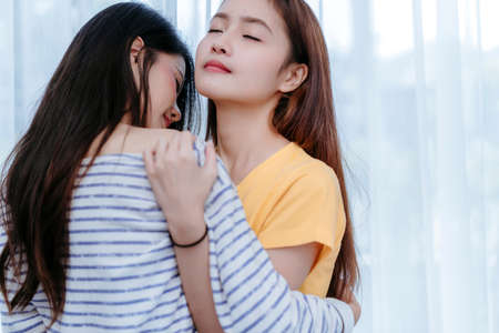 Same asian couple lover embrace and kiss scene in the bedroom happiness feeling, LGBT female hug living together at home.
