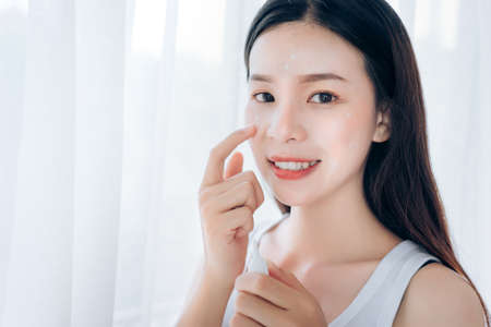 Beauty Asian Woman use Acne Gel Skincare after Cleansing on Face His Happiness,Copy Space. Stock Photo