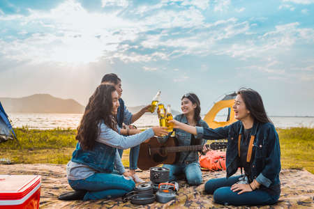 Diversity women party clink bottles enjoy camping,trekking,travel in vacation time relax. Stock Photo