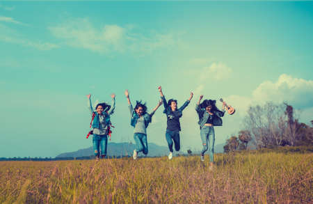 Group of Young Asian women jumping enjoy travel trekking to destination in vacation time for go to camping.