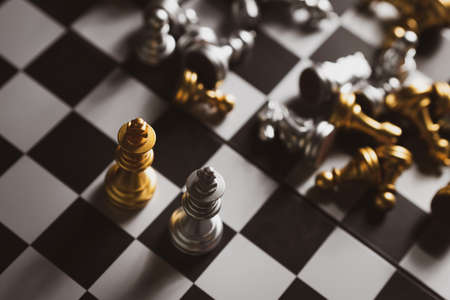 Gold and Silver Chess game king staying on chessboard, Business planing strong concept