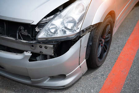 Close up crash car broken and scratch accident  insurance helping repair service maintenance waiting mechanic examining, Safety inspection test before driving on road, Transportation vehicle service