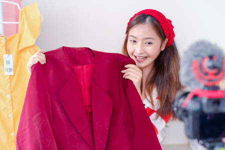Beautiful young Asian woman vlogger blogging presentation clothing fashion video live social media recording her selling online via digital camera, Owner small business entrepreneur people lifestyle Stockfoto