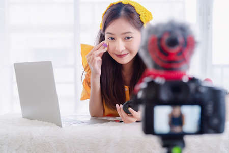 Beauty blogger young Asian woman presentation training makeup skincare video live recording online via digital camera, Vlogger owner small business entrepreneur people lifestyle