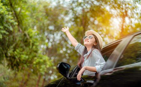 Enjoy Car travel of woman driving with sunglasses journey at nature forest in summer vacation road trip on holidays to destination, Traveler transportation vehicle people lifestyle