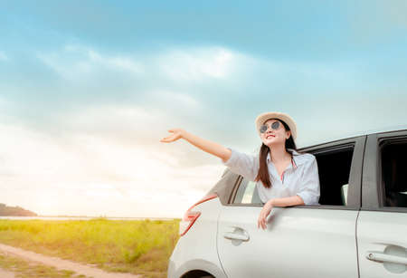 Car travel of woman journey with suitcase open window at lake and river in summer vacation road trip on holidays to destination, Traveler transportation vehicle people lifestyle