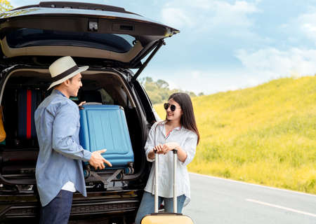 Happy couple asian family with car travel driving and suitcase at mountain road and street in vacation summer road trip on holidays to destination, Traveler transportation vehicle people lifestyle