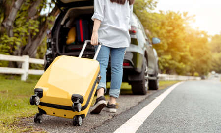 Car travel of woman journey with suitcase open suv car at mountain road and street in summer vacation road trip on holidays to destination, Traveler transportation vehicle people lifestyle