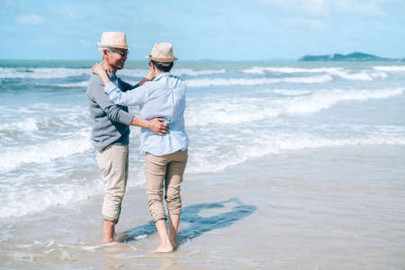 Asian couple senior elder dancing retirement resting relax at sunset beach honeymoon family together happiness people lifestyle Zdjęcie Seryjne