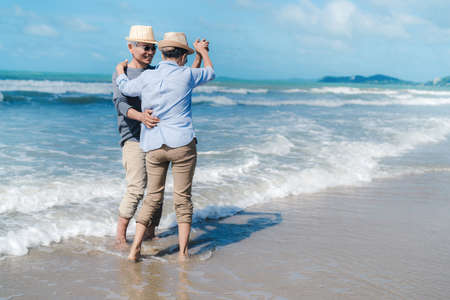 Asian couple senior elder retirement resting relax dancing at sunset beach honeymoon family together happiness people lifestyle Standard-Bild - 131655405