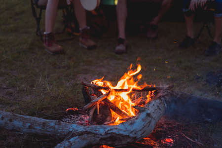 Friends group travel campfire together in forest with backpack and tent at nature outdoor relax,rest near mountain lake river
