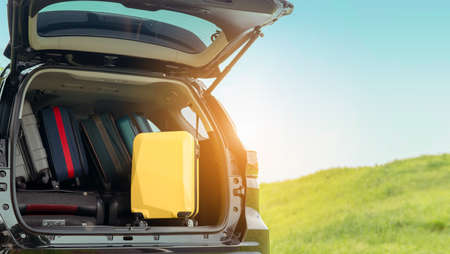 Suitcase backpack in SUV car truck for packing travel driving at mountain road and street in vacation summer road trip on holidays to destination, Traveler transportation vehicle people lifestyle