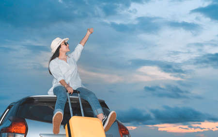 Car travel of woman journey with suitcase on hatchback car at lake river mountain and street in summer vacation road trip on holidays to destination, Traveler transportation vehicle people lifestyle