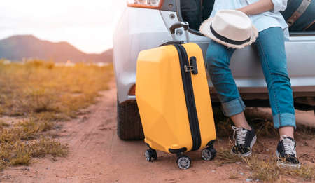 Car travel of woman journey with suitcase open hatchback car at lake river mountain and street in summer vacation road trip on holidays to destination, Traveler transportation people lifestyle