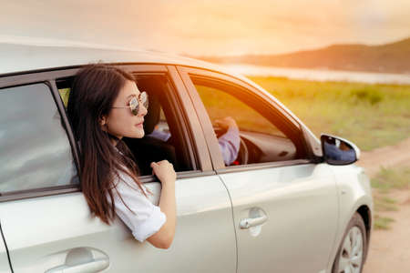 Enjoy Car travel of woman friends group driving with sunglasses journey at nature lake river in summer vacation road trip on holidays to destination, Traveler transportation vehicle people lifestyle  Stockfoto