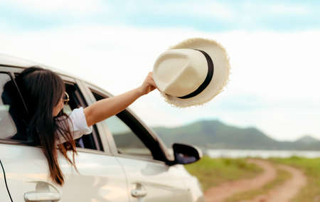 Enjoy Car travel of woman friends group driving with raising arm journey at nature lake river in summer vacation road trip on holidays to destination, Traveler transportation vehicle people lifestyle  Stockfoto