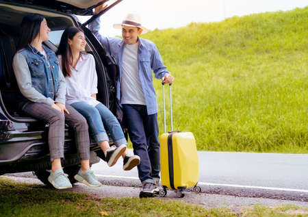 Happy asian group of friends with car travel driving and suitcase at mountain road and street in vacation summer road trip on holidays to destination, Traveler transportation vehicle people lifestyle