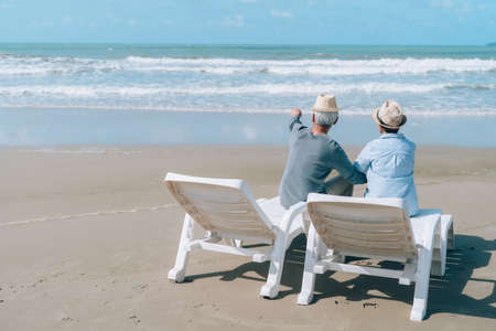 Asian couple senior elder retirement resting at beach honeymoon family together happiness people lifestyle Zdjęcie Seryjne