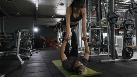 Healthy two people young asian couple doing planking exercise, Man and woman workout couple together healthy lifestyle bodybuilding muscle in the fitness gym.