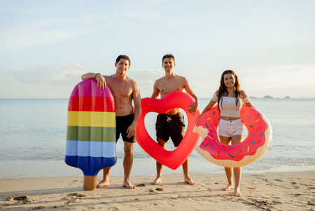 Group friends enjoy life playing and freedom beach at sunset, Attractive together of asian male and female traveler with friends people lifestyle. Stockfoto