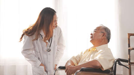 Female nurse doctor in uniform health check discussion senior grandfather patient at home medical visit, Elderly old male people healthcare support and encouraging the patient in life.