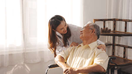 Female nurse doctor in uniform health check senior grandfather patient at home medical visit, Elderly old male people healthcare support and encouraging the patient in life.