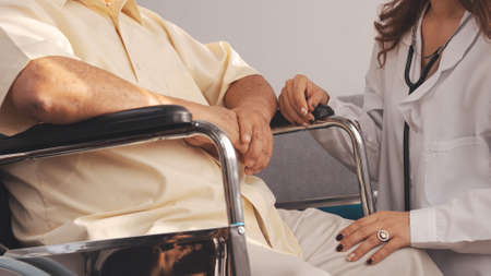 Close up Shot: Female nurse doctor in uniform health check senior grandfather patient at home medical visit, Elderly old male people healthcare support and encouraging the patient in life.
