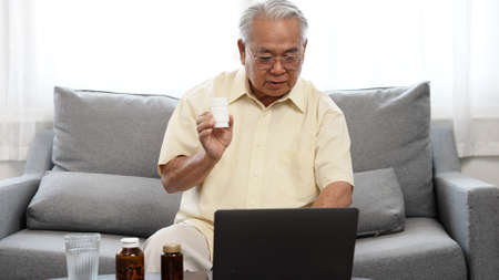 Senior male patient discuss about drug medicine with doctor in online using laptop computer digital technology wifi internet connection, Elderly retired life at home concept.