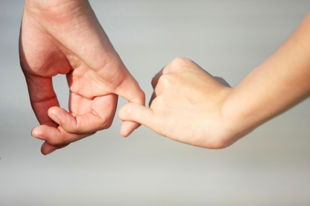 A couple make a hand on hand with love photo