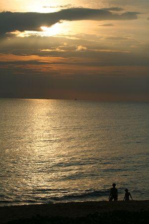 Couple walking on the beach at sunset Stock Photo - 6715866