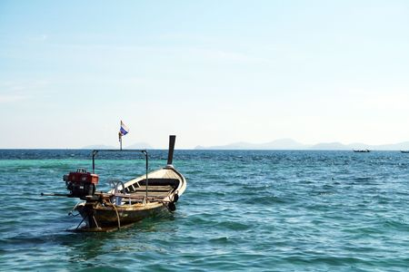 long tail boat in andaman sea photo