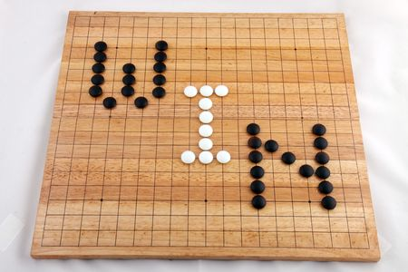 A word win on a traditional go board game Stock Photo - 6736131