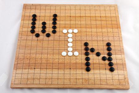 Ein Wort-Gewinn auf ein traditionelles gehen Brettspiel  Standard-Bild - 6736131