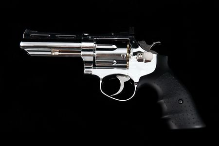 A Revolver Gun on a black background photo