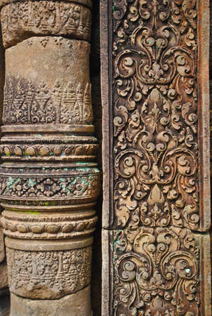 carving: Red stone carving and green lichen ,  Banteay Srei Temple ,Siem Reap, Cambodia.  Stock Photo