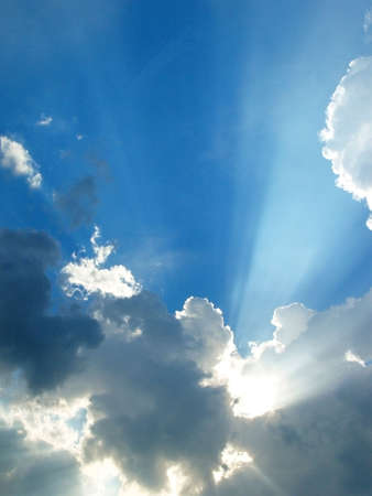 dramatic clouds: Sun shining through clouds in the sky  Stock Photo