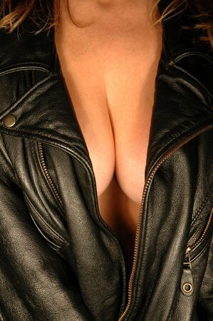 woman wearing heavy motorcycle jacket showing cleavage
