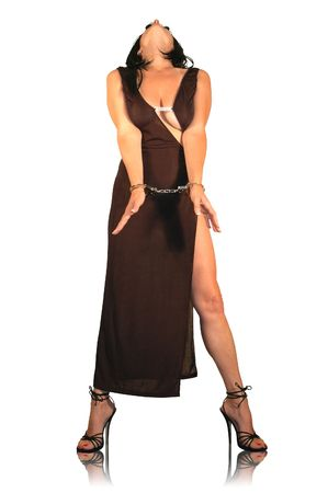 woman in long black dress and high heels, bound in handcuffs.