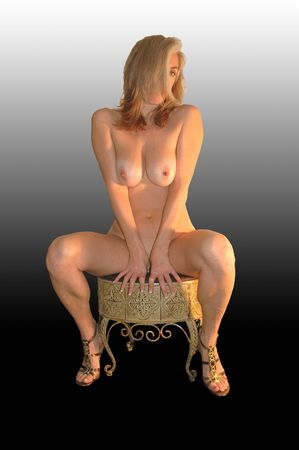 nude model on small vanity stool.
