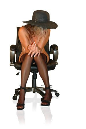 blond model wearing thigh highs, heels, and hat in office chair. Stock Photo