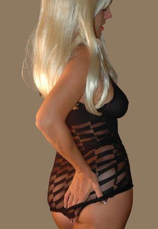 blond model wearing sheer black mini dress. Stock Photo - 1512225