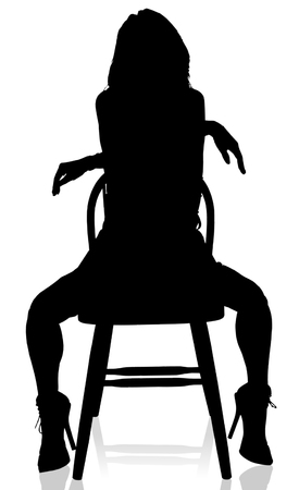 silhouette of exotic female dancer in a provacative pose.