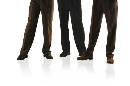 waist down shot of 3 business men in slacks. Stock Photo