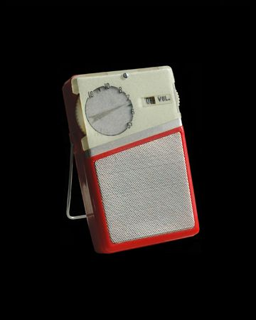 red white and chrome 1950s transistor radio on stand.