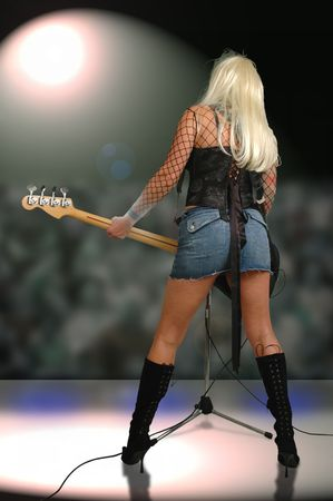 female rock star playing to the crowd.