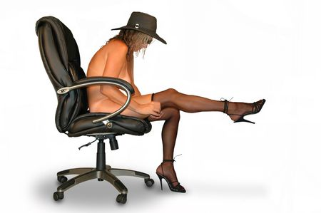 semi- model seated in office chair pulling up stockings. Stock Photo